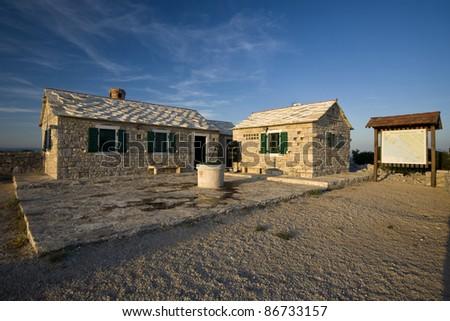 Stonemade buildings on Kamenjak in the Vrana nature park - stock photo