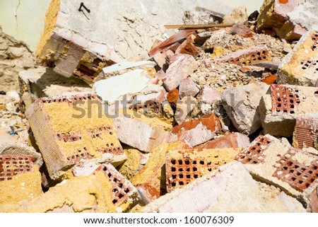 Stones and bricks of a demolished house. - stock photo