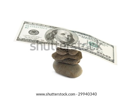 stones and money on a white background - stock photo