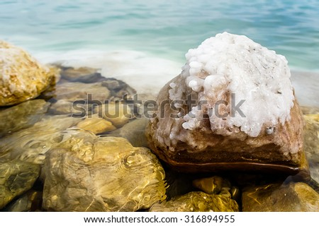 Stones covered with salt crystals, Dead Sea, Israel - stock photo