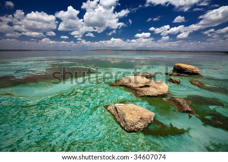 Stones in a coastal lake - stock photo