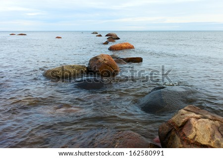 Stones in gulf of Riga, Baltic sea at latvian coast.