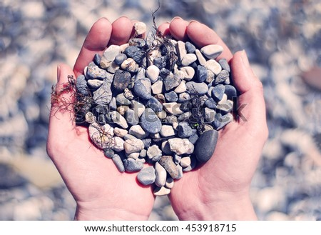 Stones in hands. Abstract conept - stock photo