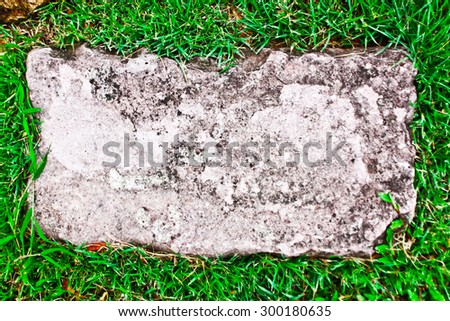 Stones in the grass - stock photo