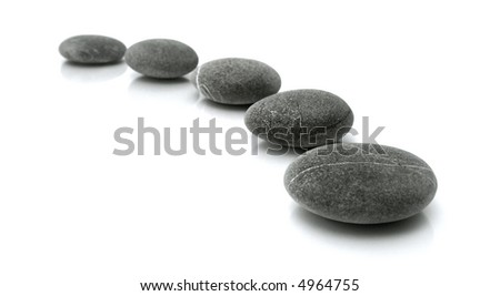 stones in the line on white background - stock photo
