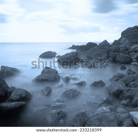 Stones in the surf. Long exposure shot taken near Feodosia, Crimea, Ukraine.