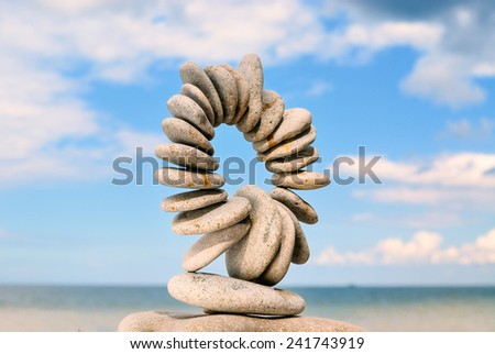 Stones laid out in the form of a circle on the sea coast  - stock photo