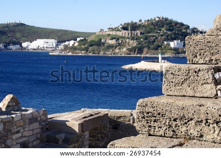 Stones of Bodrum castle St Peter's and sea, Turkey - stock photo