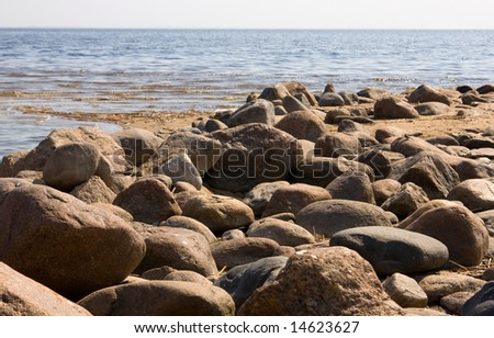Stones on a background of the  blue sea