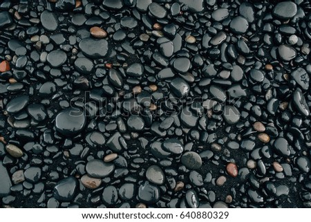 Stones on a black beach in Iceland