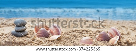 stones on sea sand - stock photo