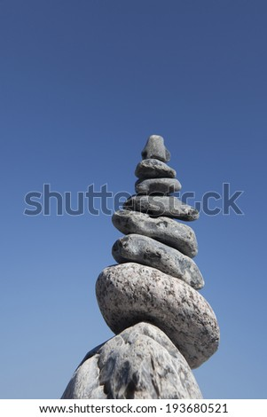 stones on the beach with blue sky - stock photo