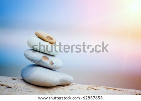 stones on the beach zen-like but authentic, natural beach stones - stock photo