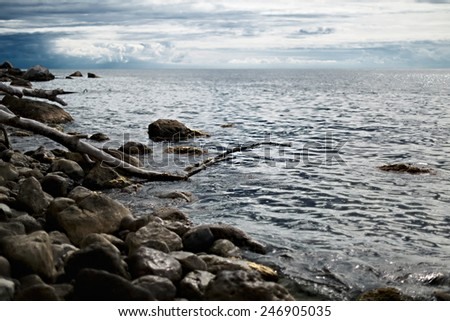 Stones on the Black Sea coast on a cloudy day - stock photo