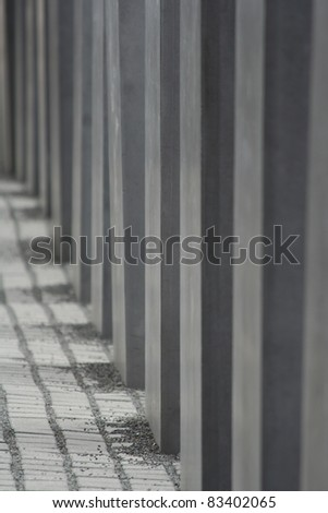 Stones on the floor and parts of the concrete steels of the Holocaust Memorial site in Berlin - stock photo