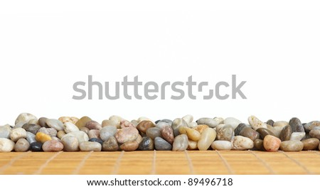 Stones on white background. Spa massage concept background. - stock photo