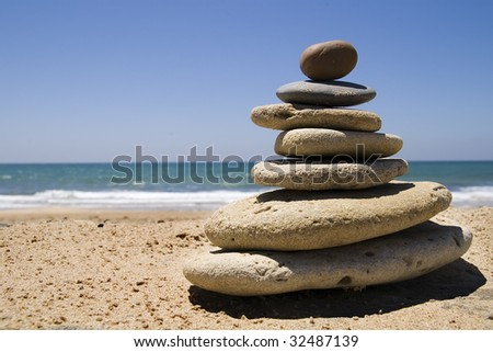 stones placed in a pyramid on a beach