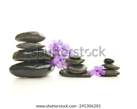 Stones pyramid with a flower, isolated on white background - stock photo
