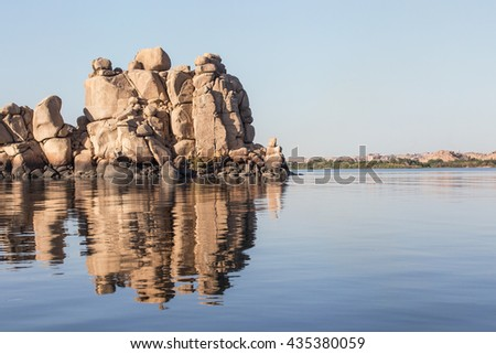 Stones River landscape. Rocks and stones near the island of Philae at Aswan, Egypt. - stock photo