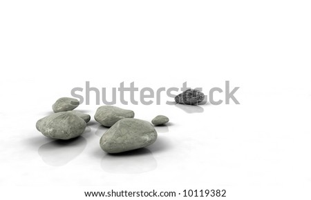 stones scattered on white reflected background - stock photo