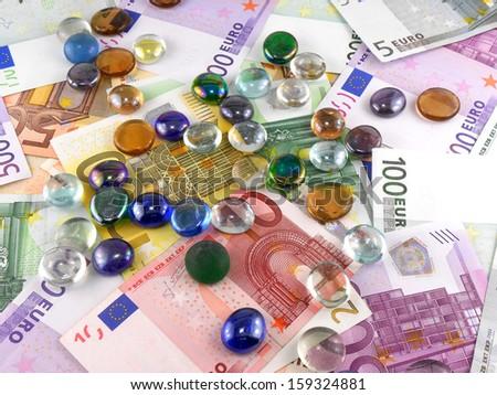 stones set on euro money background - stock photo