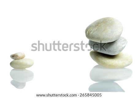 Stones stacked isolated with reflection - stock photo