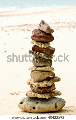stones stacked on the beach - stock photo