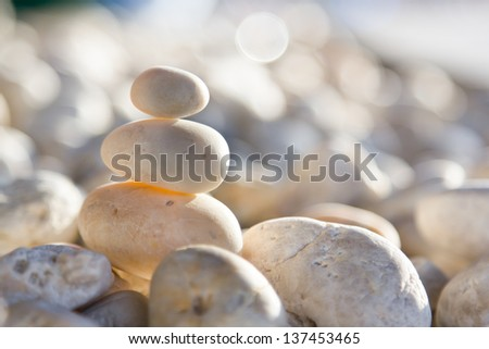 Stones stacked on the sand background. - stock photo