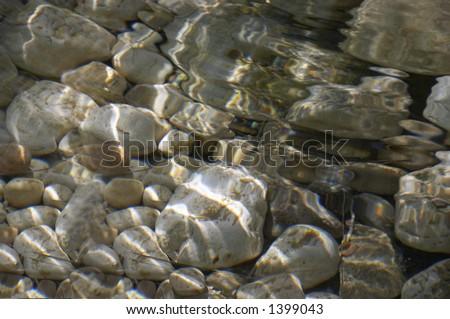 Stones under water - stock photo
