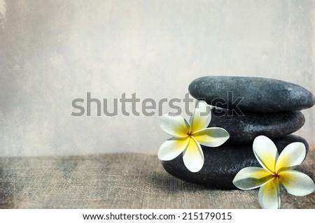 stones with frangipani  - stock photo