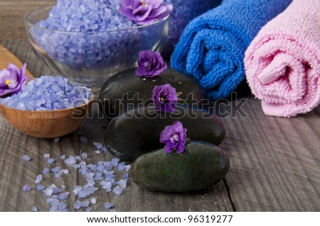 stones with purple flower and lavender salt