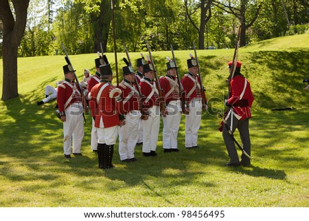 STONEY CREEK, ONTARIO, CANADA - JUNE 6 : Military inspection during a War of 1812 re-enactment at Stoney Creek Onatio Canada June 6, 2011