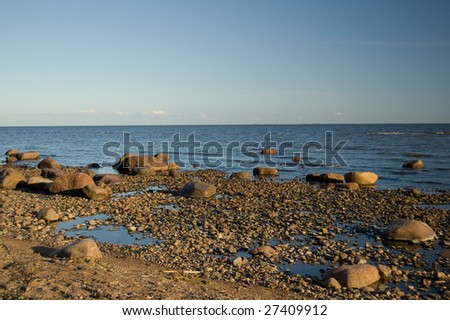 "stony beach of the ""Gulf of Finland"" in the summer evening"