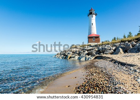 Stony Lake Superior Beach with Crisp Point Light in the background.  - stock photo