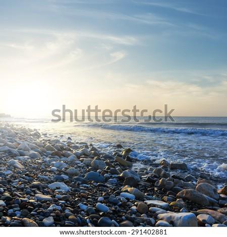 stony sea beach scene - stock photo