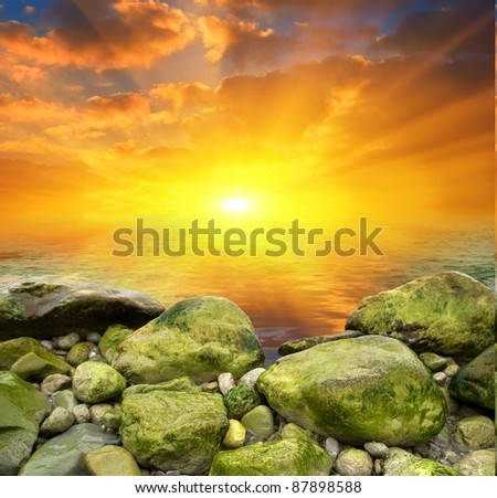 stony sea coast at the sunset - stock photo