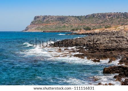 Stony shore near Sissi. Crete, Greece - stock photo