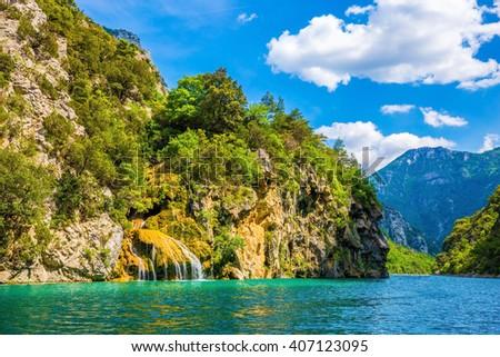 Stony slopes of canyon go down in azure the rivers Verdon. National park Merkantur, Provence - stock photo
