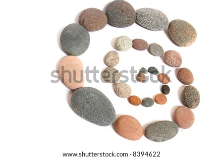 Stony spiral. Abstract background made from pebbles, on white - stock photo