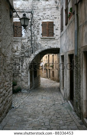 Stony street with the archway - stock photo