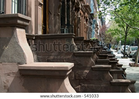 stoops in neighborhood on Upper West Side in NYC - stock photo