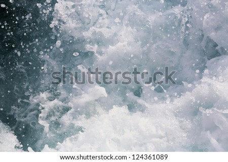 Stop action Churning sea water with high shutter speed - stock photo