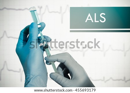 Stop ALS (amyotrophic lateral sclerosis). Syringe is filled with injection - stock photo