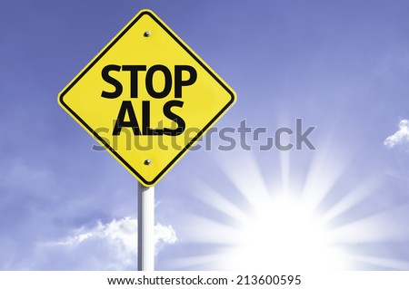 Stop ALS road sign with sun background  - stock photo