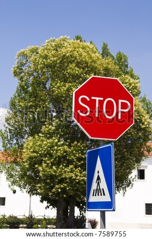 Stop and crosswalk road signs - stock photo