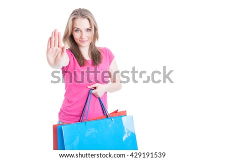 Stop and shop concept with beautiful female and her shopping multicolored bags with advertising area isolated on white - stock photo
