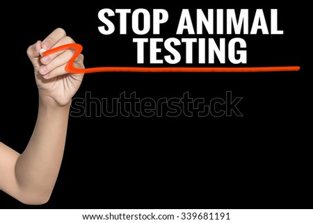 Stop Animal Testing word write on black background by woman hand holding highlighter pen - stock photo