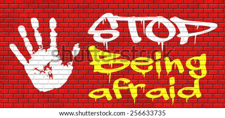 stop being afraid fear for snakes height needles spiders darkness arachnaphobia phobia psycholigical paralysis panic attack graffiti on red brick wall, text and hand - stock photo