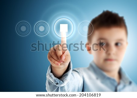 Stop. Boy pressing a virtual touch screen. Blue background. - stock photo