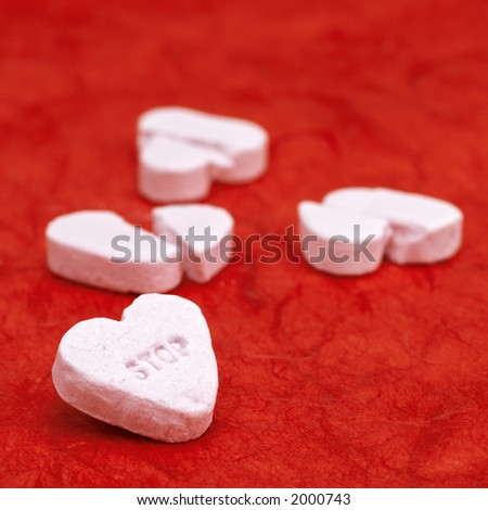 stop ! broken hearts on a red background - stock photo